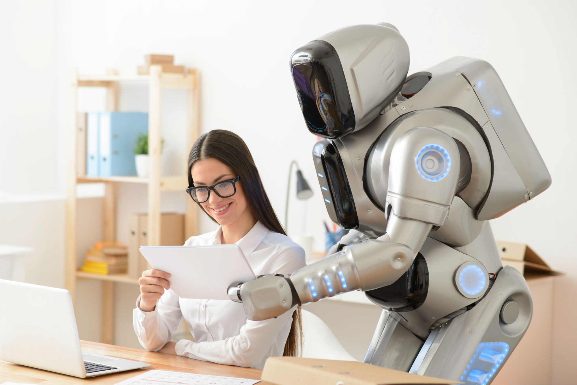 Woman working with a robot