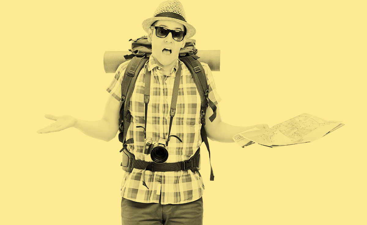 confused-traveller-with-map-sepia.jpg