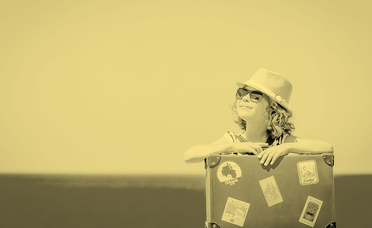 kid-with-suitcase-sepia.jpg